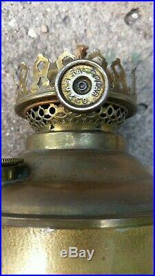 1910 W. B. Brown mission oak green slag glass table lamp, Miller oil lamp insert