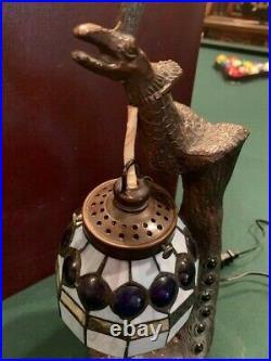 Bronzed figural peacock desk lamp jeweled, slag glass shade